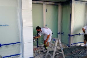 painter spraying painting commercial building Sydney CBD
